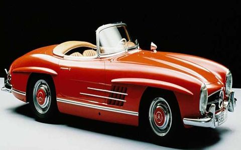 1957-63 MERCEDES-BENZ 300 SL ROADSTER:  Following closely on the 300 SL Gullwing, the roadster sported slightly softer styling. From the waistline down, it was the same car as the Gullwing coupe and still supported the 212-hp, 3.0-liter, fuel-injected engine of its predecessor, but it featured stacked headlights and regular doors to accommodate the cloth convertible top.