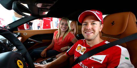 King takes a hot lap with Sebastian Vettel.