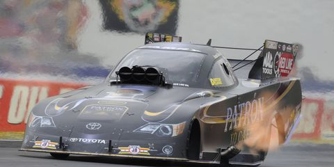 Alexis DeJoria powers her Kalitta Motorsports Patron XO Cafe Toyota Camry Funny Car to the win in Indianapolis.