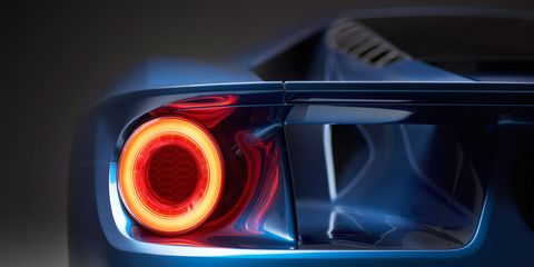 Motor vehicle, Automotive tail & brake light, Automotive design, Automotive lighting, Automotive exterior, Light, Automotive parking light, Auto part, Automotive light bulb, Sports car,