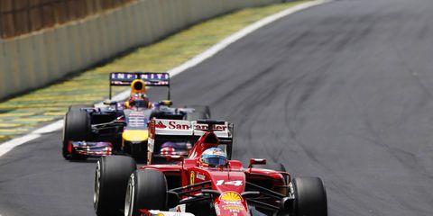 Ferrari's Fernando Alonso leading Red Bull Racing's Sebastian Vettel at the Brazilian Grand Prix.