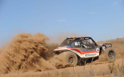 A Baja Challenge buggy spews dirt