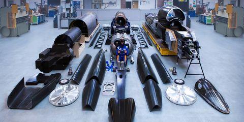 motor vehicle, automotive tire, automotive design, mode of transport, open wheel car, automotive exterior, automotive wheel system, auto part, formula one, synthetic rubber,