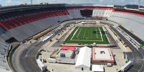 Bristol Motor Speedway in Tennessee is being transformed into a football stadium, and promoters hope to set an attendance record for a college football game.