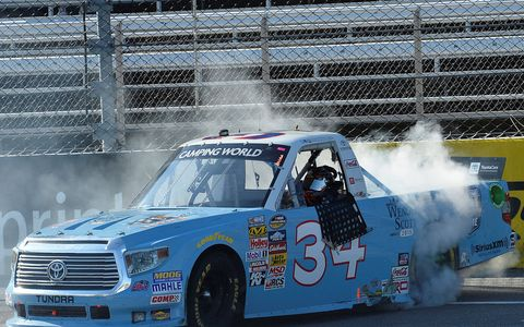 Darrell Wallace Jr. does the customary burnout after winning at Martinsville on Saturday.