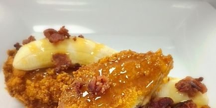 A deep-fried peanut butter and jelly sandwich encrusted with Cap'n Crunch, covered with bacon crumbles, fresh sliced bananas and caramel drizzle graces the menu this weekend at Phoenix International Raceway.