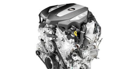 Engine, Font, Motorcycle accessories, Auto part, Machine, Automotive engine part, Automotive engine timing part, Automotive super charger part, Silver, Automotive fuel system,