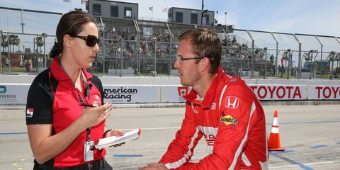 Cara Adams talks tires with Verizon IndyCar Series driver Sebastien Boudais.