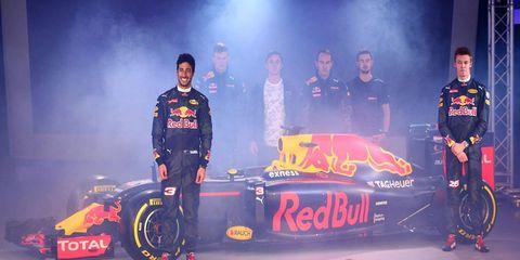 Daniel Ricciardo, left, and Daniil Kvyat, right, show off the new livery for Red Bull's 2016 F1 effort.
