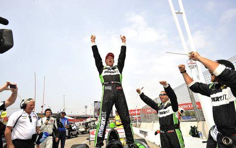 Sebastien Bourdais celebrates his IndyCar Series win in Toronto on Sunday.
