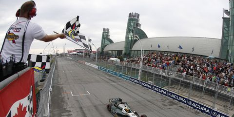 Mike Conway takes the checkered flag after winning the second race of the Sunday IndyCar doubleheader in Toronto.