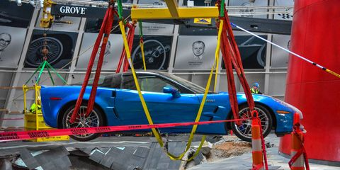 The Corvette Blue Devil being extracted from the sinkhole at the National Corvette Museum.