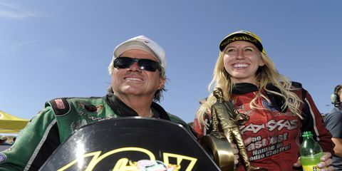 Courtney Force, right, topped 16-time NHRA Funny Car champion John Force, left, on Sunday at Sonoma.