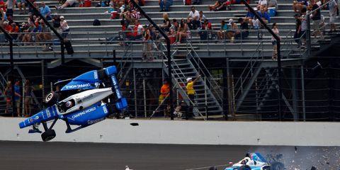 Jay Howard, Scott Dixon crash during the Indy 500 Sunday.