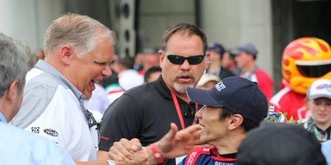 Honda's Art St. Cyr congratulates Takuma Sato after Sato won the Indianapolis 500 on Sunday.
