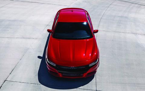 Automotive design, Hood, Car, Automotive exterior, Red, Automotive lighting, Automotive parking light, Glass, Automotive mirror, Road surface,