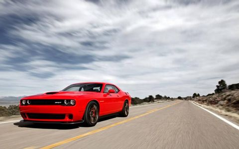 Driving the 2015 Dodge Challenger SRT Hellcat is like taming a rocket.