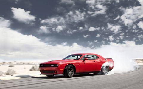 Tire, Wheel, Automotive tire, Automotive design, Vehicle, Land vehicle, Automotive exterior, Automotive lighting, Hood, Cloud,