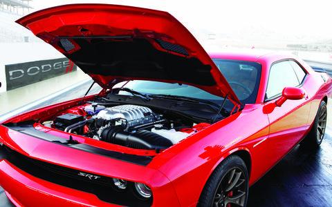 Tire, Automotive design, Vehicle, Hood, Land vehicle, Automotive tire, Performance car, Car, Red, Headlamp,
