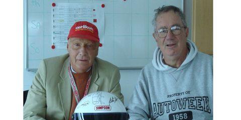 Autoweek NASCAR writer Al Pearce (right) got F1 champion Niki Lauda to sign a helmet in Vienna.