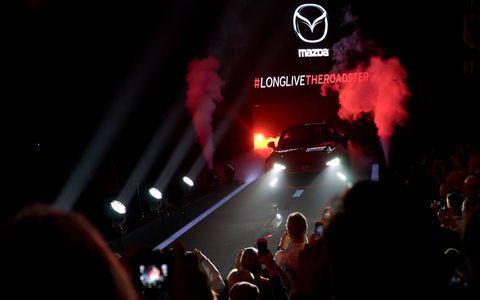 Crowd, Logo, Audience, Brand, Graphics, Visual effect lighting, Smoke,