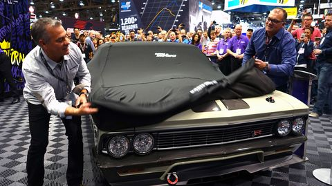 Brothers Jim (left) and Mike Ring unveil their latest creation at the 2014 SEMA Show.
