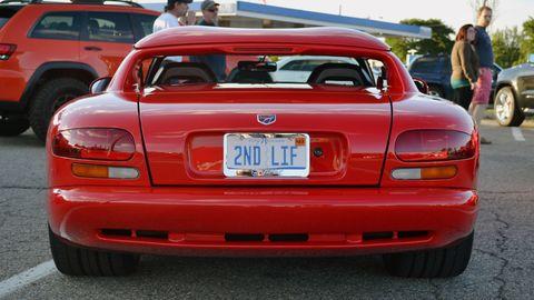 Automotive design, Vehicle, Land vehicle, Automotive tail & brake light, Vehicle registration plate, Automotive exterior, Automotive lighting, Automotive parking light, Car, Red,