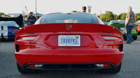 Motor vehicle, Mode of transport, Automotive design, Vehicle registration plate, Vehicle, Land vehicle, Automotive lighting, Performance car, Red, Automotive exterior,