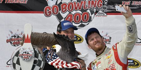Dale Earnhardt Jr. taking a selfie with with a broom after his win at Pocono this past weekend.