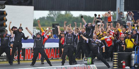 Alexis DeJoria's Kallita Motorsports crew celebrates her win over John Force in the Funny Car final at the Chevrolet Performance U.S. Nationals on Monday in Indianapolis.