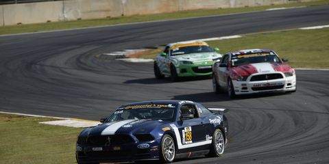 Billy Johnson and Ian James led the way in their Ford Mustang Boss 302R to win the IMSA Continental Tire SportsCar Challenge race at Road Atlanta on Friday.