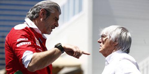F1 boss Bernie Ecclestone, right, talks to Ferrari team principal Maurizio Arrivabene at the Baku City Circuit.