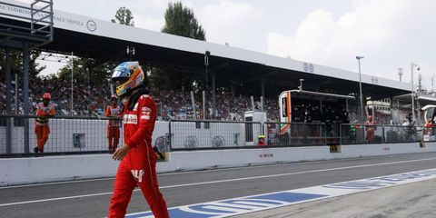 Driver Fernando Alonso walking back to his garage after retiring early at Monza. Will he soon be walking away from Ferrari Formula One?