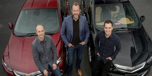 GM president Dan Ammann (center) is flanked by Lyft co-founders John Zimmer (right) and Logan Green.
