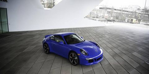 The 911 Club Coupe gets SportDesign side mirrors, black-framed bi-xenon headlights, tinted taillights and Club Coupe badges.