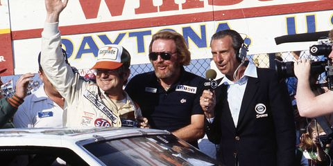 Bill Brodrick, middle, in victory lane with Bobby Allison and CBS' Ned Jarrett at Daytona in 1982.