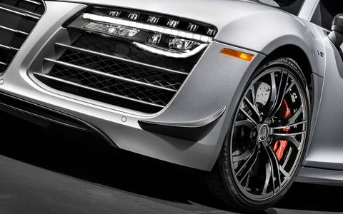 The limited-edition R8 Competition comes with 19-inch gloss black wheels and carbon ceramic brakes. Calipers are painted red, the universal signifier of sporting intent.