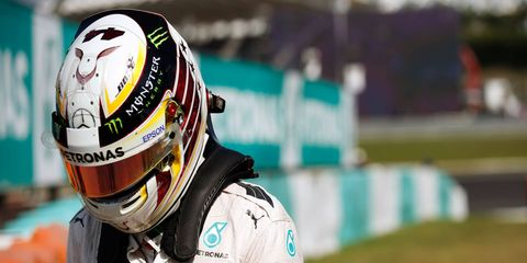 An engine failure in Malaysia left Lewis Hamilton 23 points behind teammate Nico Rosberg in the race for the Formula 1 championship.