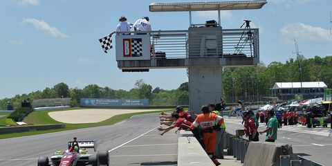Spencer Pigot takes the checkered flag on Sunday at Barber Motorsports Park in Alabama.