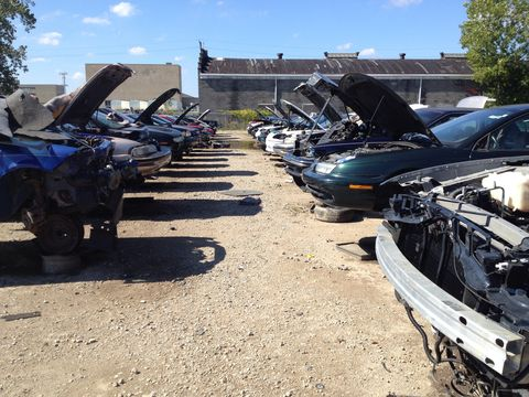 """Cars are organized by manufacturer (GM, Ford, Chrysler, Import) at this particular salvage yard, with trucks, SUVs and """"old stuff"""" getting their own sections. This is one of the 40 rows of GM products showing a handful of Saturns, an F-body and an Olds 98, among others."""