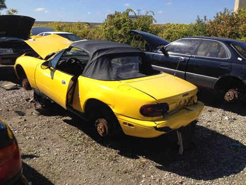 An NA Miata -- the first MX-5 I've seen at a junkyard, for that matter. It's well picked over but it's not rusty, so I wonder why it's in here?