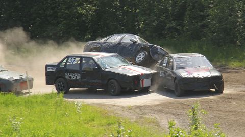 The drivers were good about not punting each other into the woods on purpose, but the tight confines and short race heats led to quite a bit of rubbin' and bumpin'. Here's Daniel Nordin's Opel climbing up onto Jan Kastberg's Volvo and Sven-Inge Sjödin's BMW. Fortunately, the Opel ended up on its wheels in this incident.