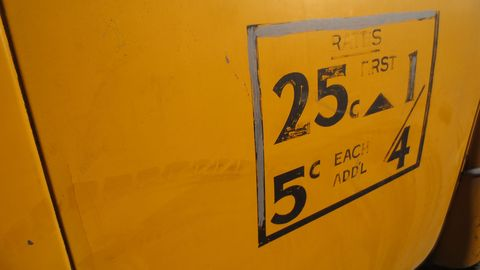 Either a real taxi sat forgotten for the 50 years since fares were so low, or this sign was painted more recently.