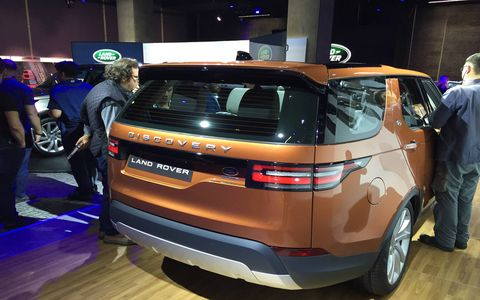 Shot at the Discovery's Paris reveal, the rear 3/4 view shows design ties with the previous LR4, including the offset license plate, raised rear roof and squared-off shoulders.