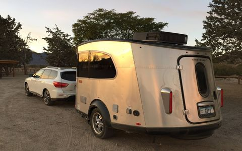 The new Airstream Basecamp sleeps two and has everything you'd want in a trailer: from shower and commode to heater, hot water, sink, propane stove and fridge. All that's missing is Wi-Fi and a TV. Pricing starts at $34,900. That's our Pathfinder tow vehicle.