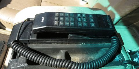 The final owner of this BMW car phone couldn't bear to remove it, many years after its networks were switched off.