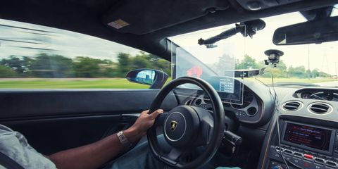 """Race against yourself with GhostDash, a heads-up system that combines recorded and real-time telemetry to recreate the """"ghost"""" feature popular in driving video games."""