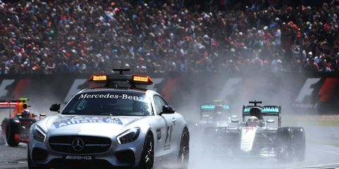 The safety car was the star of the opening act at Silverstone as cars paraded on a wet surface early on.
