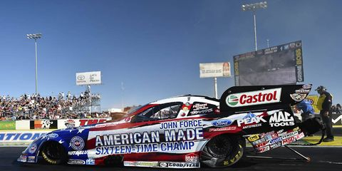 John Force, in a special paint scheme on his Ford Mustang celebrating his 16 NHRA Funny Car championships, took the qualifying lead at Las Vegas on Friday.