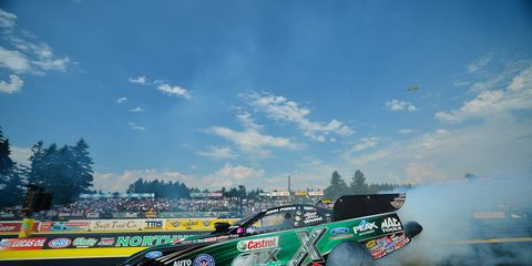 John Force set a track record with his final pass on Saturday night to win his 150th career top-qualifying spot.